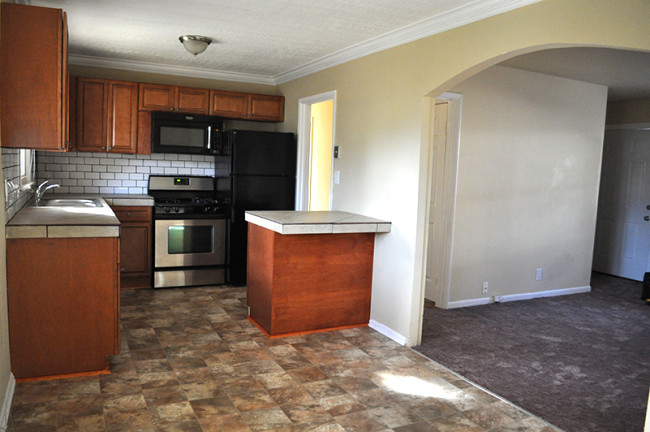 Rental property - New cabinets, countertops, backsplash, flooring and trim.